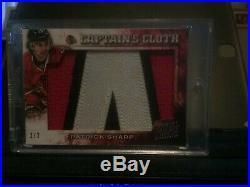 2013/14 Patrick Sharp Captain's Cloth patch cards #ed 1,2/2 (CHICAGO BLACKHAWKS)